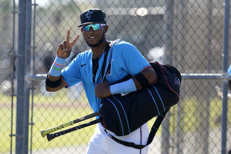 FILE - Miami Marlins' Lewin Diaz jogs between fields during spring training baseball practice in Jupiter, Fla., in this Friday, Feb. 26, 2021, file photo. For the Jeter regime, instant success hasn't happened at all. Four of the Marlins' top 12 prospects made their MLB debuts last year, and none batted above .170. (AP Photo/Jeff Roberson, File)