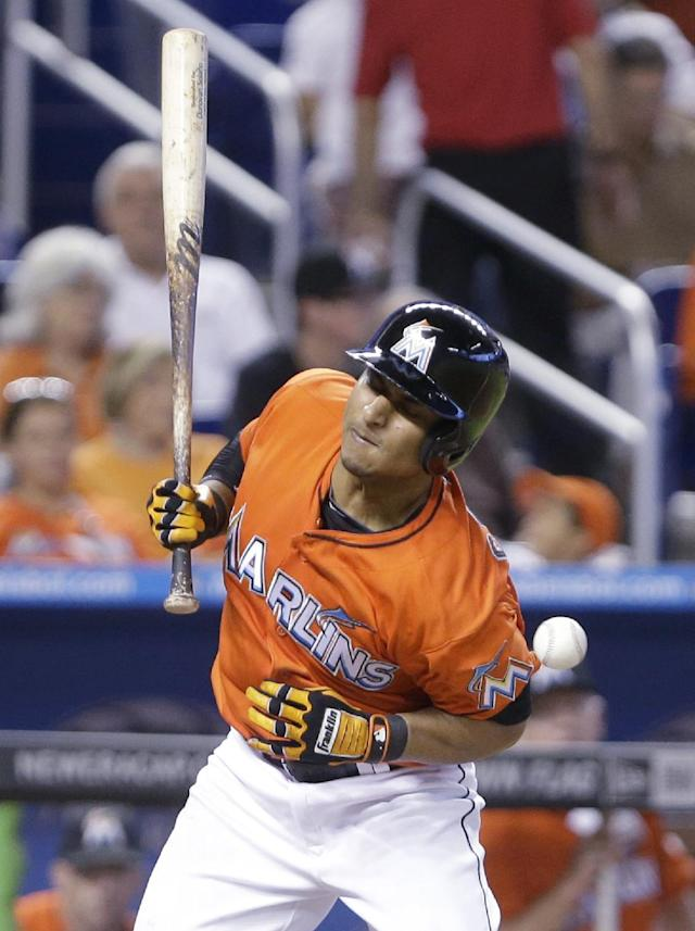 Miami Marlins' Donovan Solano is hit by a pitch during the sixth inning of a baseball game against the Washington Nationals, Sunday, Sept. 8, 2013, in Miami. The Nationals defeated the Marlins 6-4. (AP Photo/Wilfredo Lee)