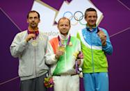 LONDON, ENGLAND - AUGUST 03: (L-R) Silver medalist Lionel Cox of Belgium, gold medalist Sergei Martynov of Belarus and bronze medalist Rajmond Debevec of Slovenia pose on the podium during the medal ceremony for theMen's 50m Rifle Prone Shooting qualification on Day 7 of the London 2012 Olympic Games at The Royal Artillery Barracks on August 3, 2012 in London, England. (Photo by Lars Baron/Getty Images)