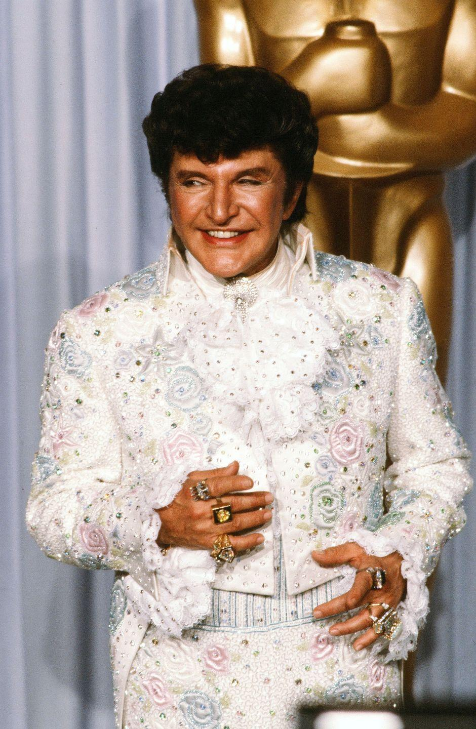 <p>Proving sparkles are not just for women, legendary pianist Liberace is best remembered for his flashy costumes.</p>