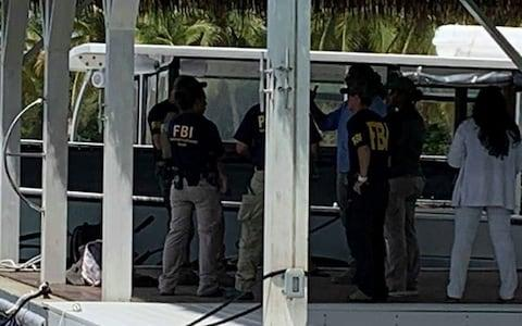 FBI agents are seen at Little St. James Island, one of the properties of late financier Jeffrey Epstein - Credit: Reuters