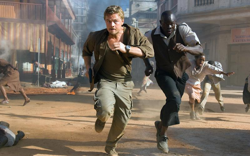 "Leonardo DiCaprio, left, and Djimon Hounsou in a scene from the Oscar nominated ""Blood Diamond.""  - Credit:  JAAP BUITENDIJK/AP"