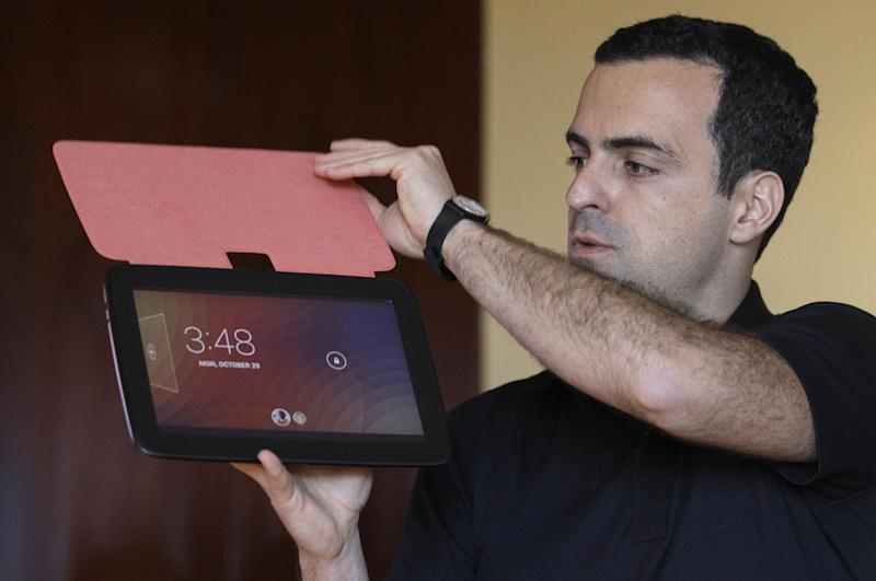 FILE - In this Monday, Monday, Oct. 29, 2012, file photo, Hugo Barra, Android at Google Director of Product Management, holds up the Nexus 10 tablet at a Google announcement in San Francisco. Tablets are at the top of many wish lists this holiday season. The choice used to be pretty limited, with the iPad dominating over the latecomers. But this year, the field is more even, as tablets from Apple's competitors have matured. In addition, Google and Microsoft have dived in with their own tablets, providing more choice. (AP Photo/Jeff Chiu)