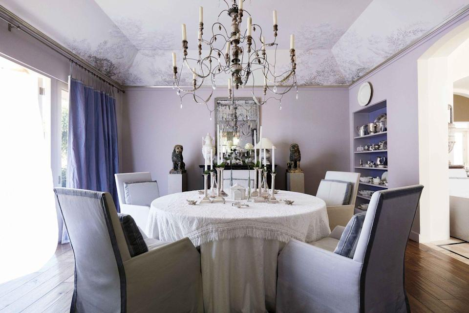 """<p>A delicate hand-painted ceiling mural of trailing vines tops the dining room of designer <a href=""""https://www.saladinostyle.com"""" rel=""""nofollow noopener"""" target=""""_blank"""" data-ylk=""""slk:John Saladino's"""" class=""""link rapid-noclick-resp"""">John Saladino's</a> Montecito home and brings the outdoors in. The chandelier is 18th-century French, and the dining chairs are covered in a supple <a href=""""https://www.keleenleathers.com"""" rel=""""nofollow noopener"""" target=""""_blank"""" data-ylk=""""slk:Keleen"""" class=""""link rapid-noclick-resp"""">Keleen</a> leather. </p>"""