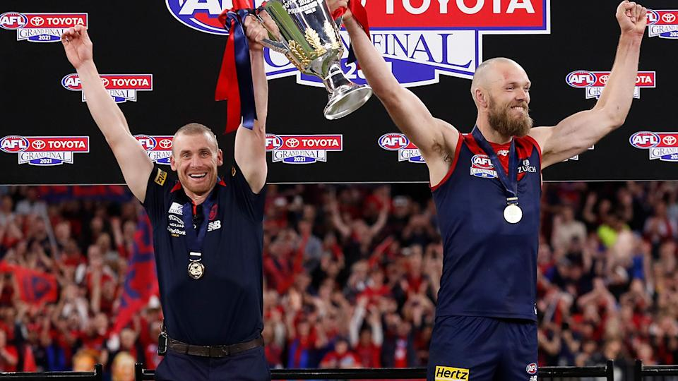 Simon Goodwin and Max Gawn, pictured here holding the cup aloft after the AFL grand final.