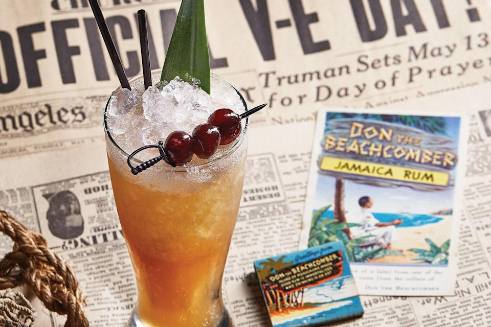 """This tiki drink gets its name from the Morse code for """"victory""""; it gets its kick from a potent blend of spicy spirits, with rum providing the foundation. <a href=""""https://www.epicurious.com/recipes/food/views/three-dots-and-a-dash?mbid=synd_yahoo_rss"""" rel=""""nofollow noopener"""" target=""""_blank"""" data-ylk=""""slk:See recipe."""" class=""""link rapid-noclick-resp"""">See recipe.</a>"""