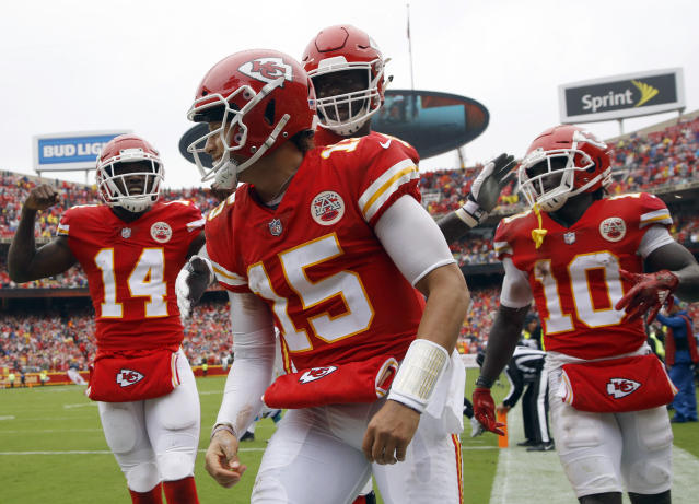Chiefs quarterback Patrick Mahomes (center) celebrates a TD during the first half of Kansas City's victory over the Jaguars. (AP)