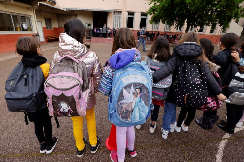 French schoolchildren return to classes under strict sanitary measures