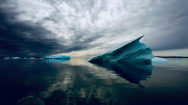 An iceberg floating in the waters of Greenland.