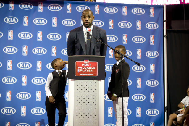 Bryce, left, and LeBron Jr. listen to their father as he accepts the 2013 NBA MVP award. (AP)
