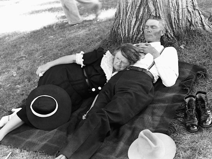A couple takes a nap on the ground following a July 4 parade in Oregon in 1941.