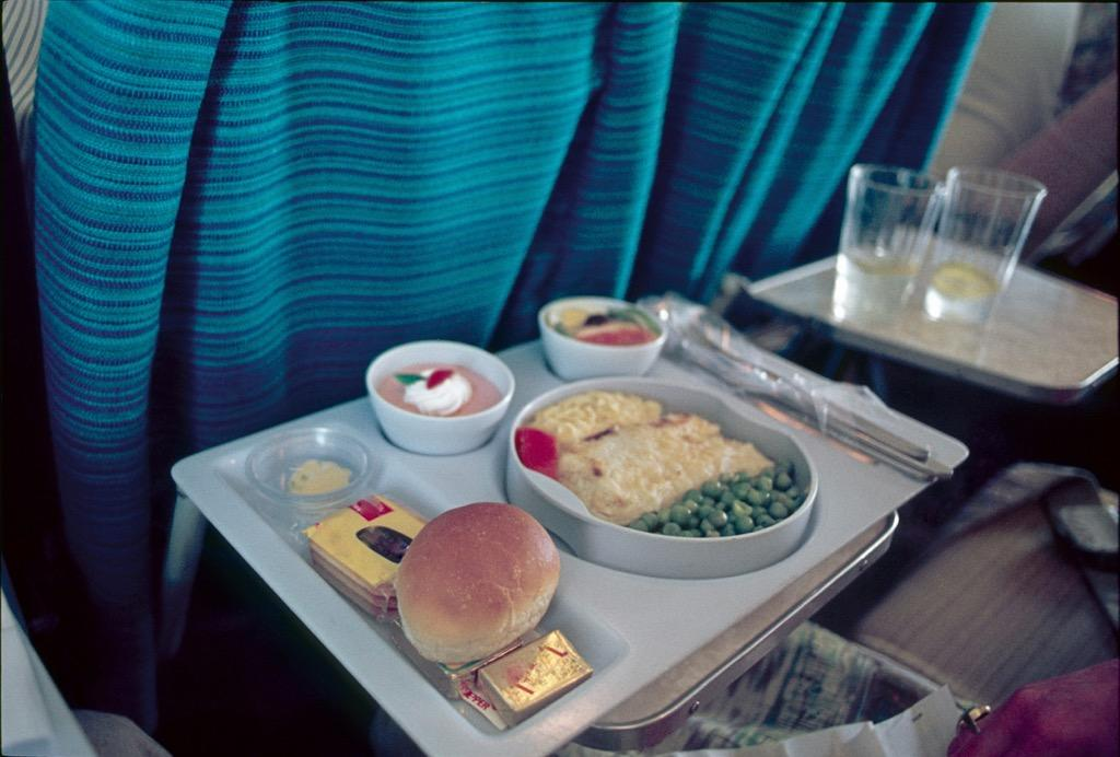 """Don't blame the airline for those lackluster in-flight meals: Our ability to perceive saltiness and sweetness drops by as much as 30 percent when we're in the air, according to a study conducted by German airline Lufthansa, as cited by <em><a href=""""https://www.wsj.com/articles/SB10001424052748703294904575384954227906006"""" target=""""_blank"""">The Wall Street Journal</a></em>.  And a 2015 study from <a href=""""https://psycnet.apa.org/doiLanding?doi=10.1037/xhp0000044"""" target=""""_blank"""">Cornell University</a> found that it's umami-rich foods like tomato juice that taste best in noisy situations like on an airplane—so if you want to enjoy what you consume while you fly at least a little bit, consider splurging on that Bloody Mary."""