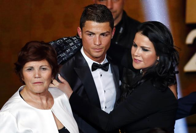 Portugal's Cristiano Ronaldo poses with his mother Dolores Aveiro and sister Katia Aveiro after being awarded the FIFA Ballon d'Or 2013 in Zurich