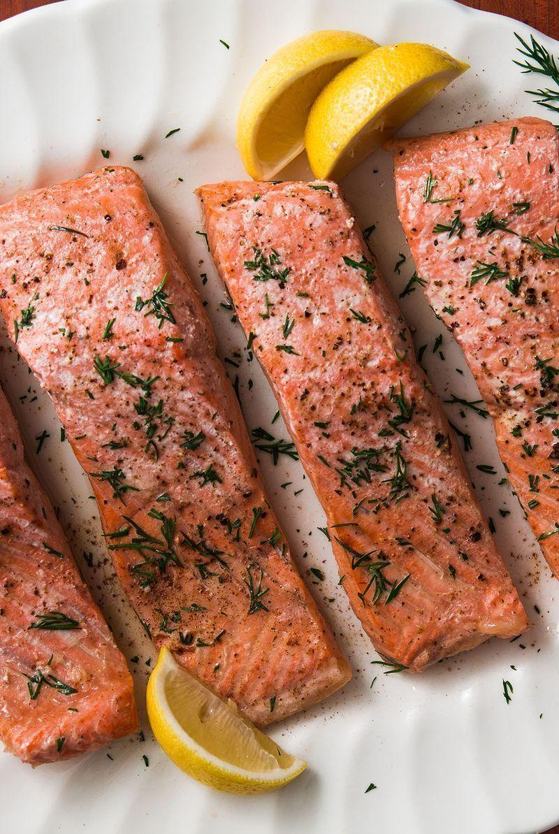 """<p>Poached salmon sounds nice and fancy but it's actually one of the easiest ways to cook salmon. It comes out perfect and tender every single time. </p><p>Get the <a href=""""https://www.delish.com/uk/cooking/recipes/a29204888/easy-poached-salmon-recipe/"""" rel=""""nofollow noopener"""" target=""""_blank"""" data-ylk=""""slk:Poached Salmon"""" class=""""link rapid-noclick-resp"""">Poached Salmon</a> recipe.</p>"""