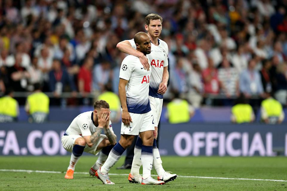 Lucas Moura was consoled by teammates after Saturday's defeat.Tottenham Hotspur FC via Getty Images