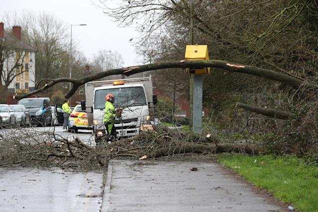 Crews clear storm damage in Tilehurst, Reading . (Jonathan Brady/PA Wire)