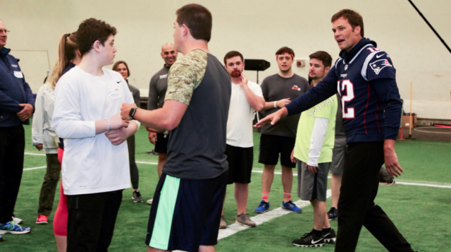 "Tom Brady, far right, has returned to the New England Patriots after spending the offseason away from team activities. Here he takes part in a Patriots' ""fantasy camp"" event on Monday, with minicamp beginning Tuesday. (New England Patriots/Twitter)"