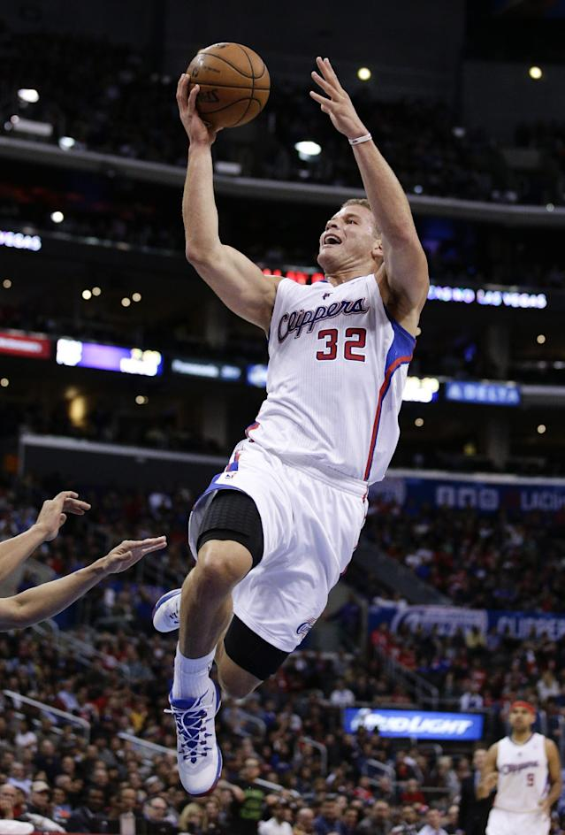 Los Angeles Clippers' Blake Griffin goes up for a basket during the first half of an NBA basketball game against the Phoenix Suns on Monday, Dec. 30, 2013, in Los Angeles. (AP Photo/Jae C. Hong)