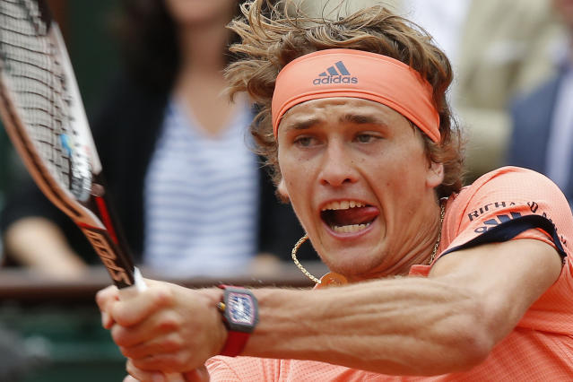 Germany's Alexander Zverev returns a shot against Bosnia and Herzegovina's Damir Dzumhur during their third round match of the French Open tennis tournament at the Roland Garros stadium in Paris, France, Friday, June 1, 2018. (AP Photo/Michel Euler)