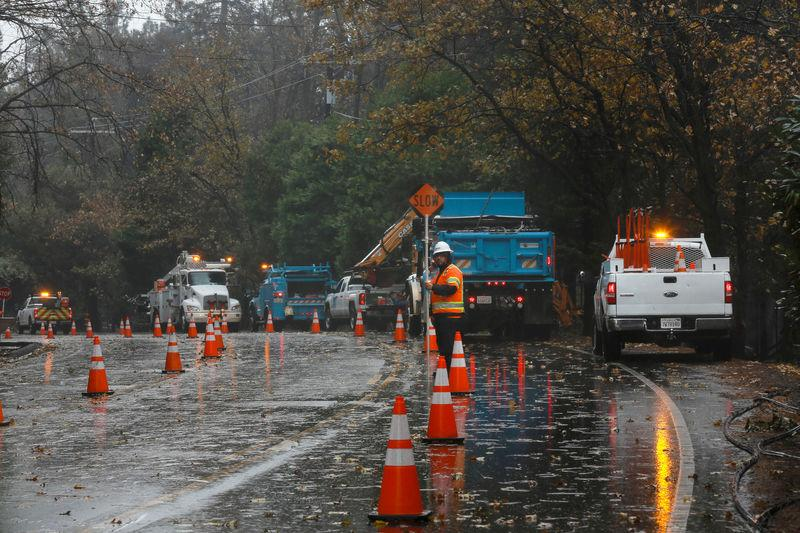 FILE PHOTO: PG&E crew work to repair damage caused by the Camp Fire in Paradise