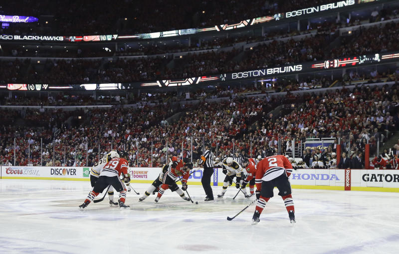 Chicago Blackhawks center Jonathan Toews (19) wins the face off at the start of Game 5 of the NHL hockey Stanley Cup Finals against the Boston Bruins, Saturday, June 22, 2013, in Chicago. (AP Photo/Nam Y. Huh)