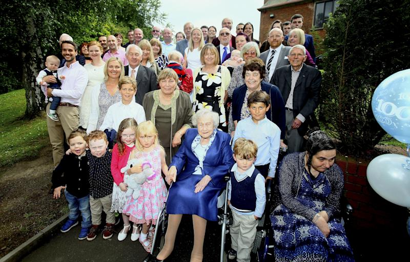 Elizabeth McLaughlin celebrated her 100th birthday in 2017 with her son and seven daughters, 18 grandchildren and 13 great-grandchildren at Christ the King Parish Hall in Glasgow. (SWNS)