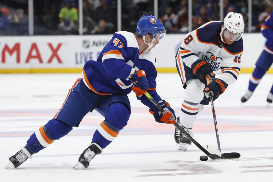 Edmonton Oilers left wing James Neal (18) defends against New York Islanders center Leo Komarov (47) during the second period of an NHL hockey game Tuesday, Oct. 8, 2019, in Uniondale, N.Y. (AP Photo/Kathy Willens)
