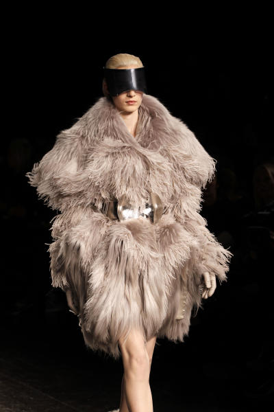 A model wears a creation by British designer Sarah Burton for Alexander McQueen as part of the Fall-Winter ready-to-wear 2013 fashion collection, during Paris Fashion week, Tuesday, March 6, 2012. (AP Photo/Christophe Ena)