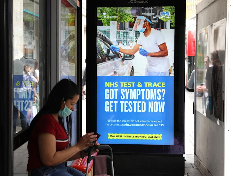 A screen on a bus stop displaying a NHS notice on test and trace on Oxford Street, London, as non-essential shops in England open their doors to customers for the first time since coronavirus lockdown restrictions were imposed in March. Picture date: Monday June 15, 2020.