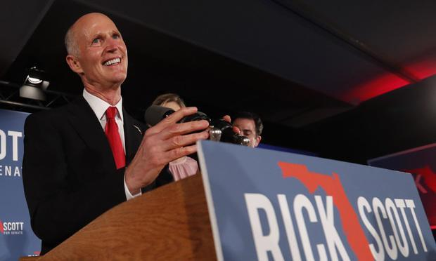 Republican Senate candidate Rick Scott smiles as he speaks to supporters at an election watch party Nov. 7 in Naples. Photo by Wilfredo Lee/AP