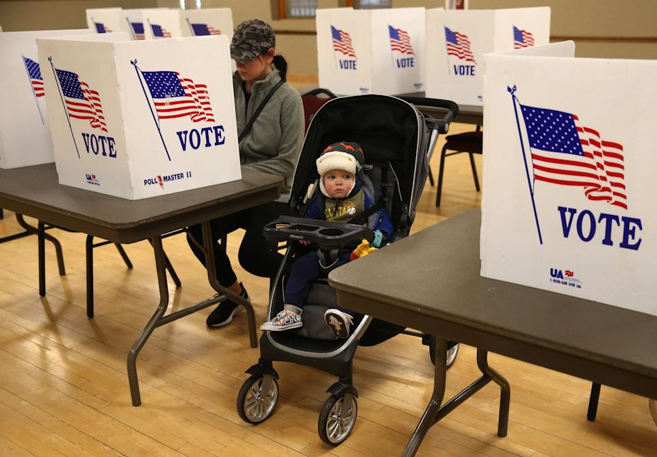 A Missouri mother casts her vote in the state's presidential primary on March 10 in St. Charles, Missouri. The exemptions that allow absentee voting in the state are limited. (Photo: Laurie Skrivan/St. Louis Post-Dispatch via Getty Images)