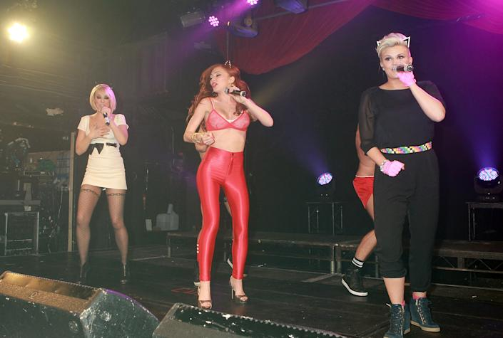 LONDON, UNITED KINGDOM - MARCH 02: Liz McClarnon, Natasha Hamilton and Kerry Katona of Atomic Kitten perform on stage at G-A-Y on March 2, 2013 in London, England. (Photo by Jo Hale/Redferns via Getty Images)