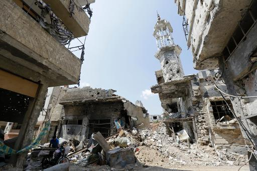 A picture taken on May 12, 2014 shows heavily damaged buildings in a destroyed neighbourhood of the Old City of Homs