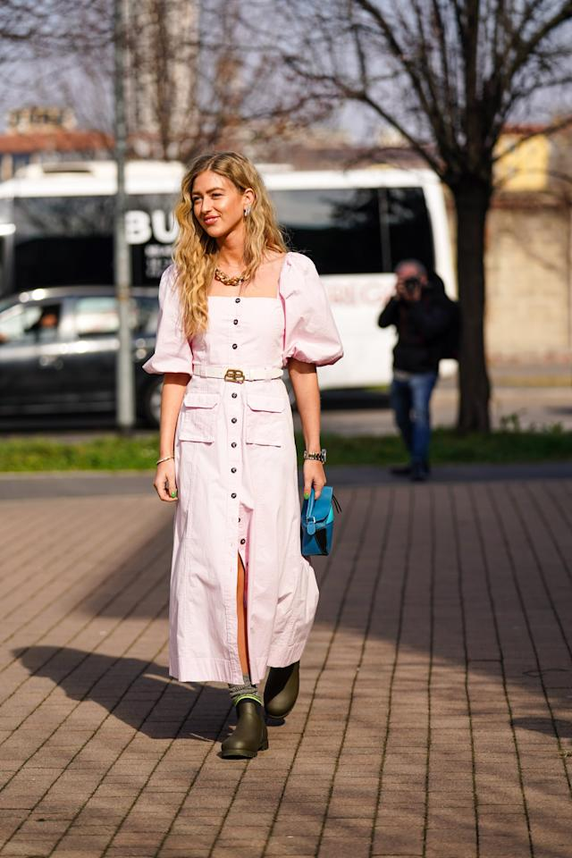 <p>Leave it to the reigning queen of color Emili Sindlev to put pink button-down dresses on my radar for Spring. Once I saw her in this, I went to work searching for the perfect soft pink button-down at an affordable price.</p>