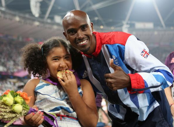 LONDON, ENGLAND - AUGUST 11:  Gold medalist Mohamed Farah of Great Britain poses with his daughter Rihanna Farah after the medal ceremony for the Men's 5000m on Day 15 of the London 2012 Olympic Games at Olympic Stadium on August 11, 2012 in London, England.  (Photo by Clive Brunskill/Getty Images)