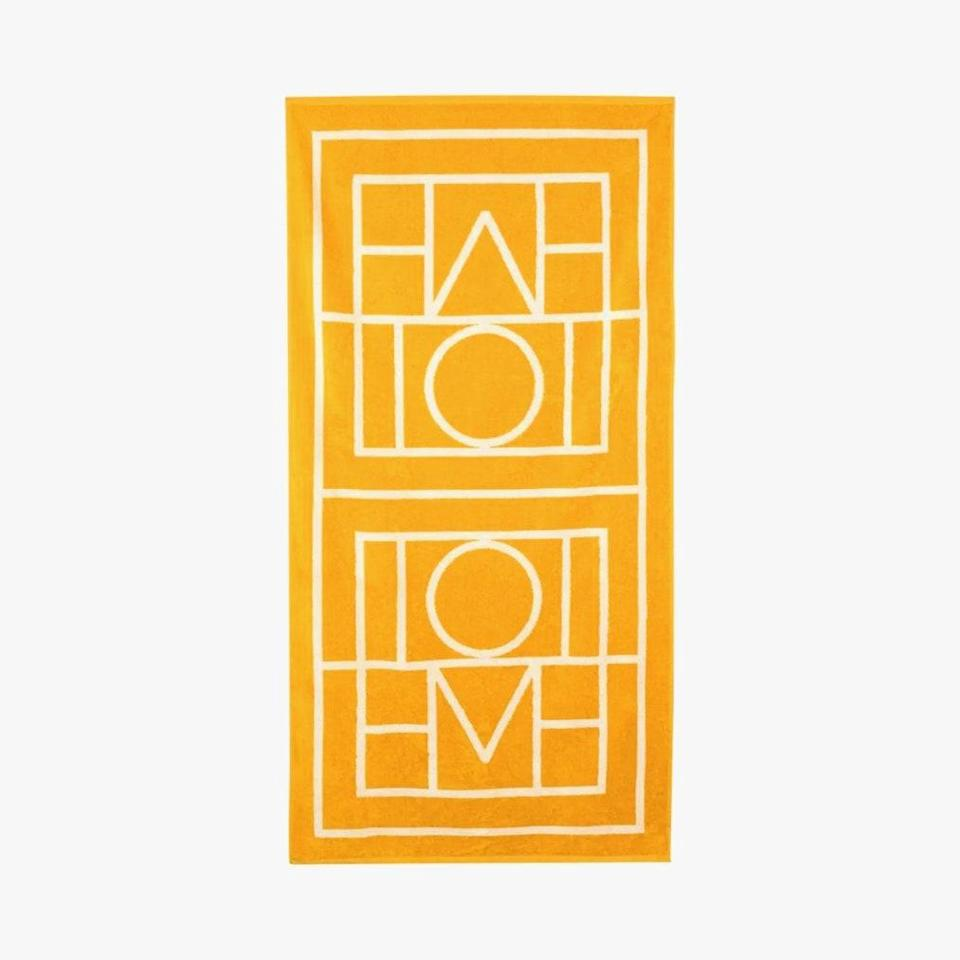 """$120, BROWNS FASHION. <a href=""""https://www.brownsfashion.com/shopping/toteme-x-browns-50-yellow-biarritz-monogram-cotton-beach-towel-15350567"""" rel=""""nofollow noopener"""" target=""""_blank"""" data-ylk=""""slk:Get it now!"""" class=""""link rapid-noclick-resp"""">Get it now!</a>"""