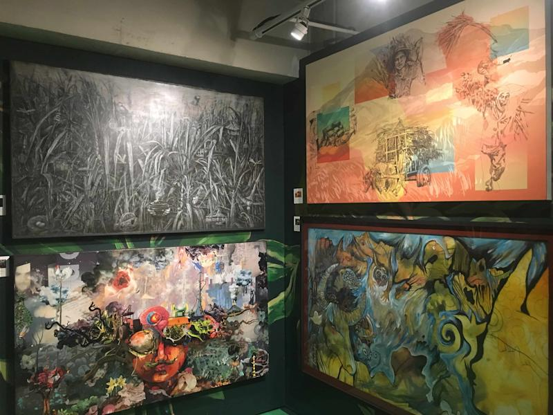 Paintings in Don Papa Rum's booth. (Photo: Therese Reyes)