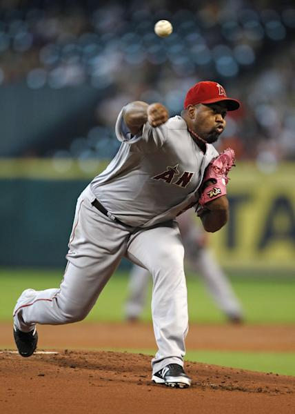 Los Angeles Angels starter Jerome Williams delivers a pitch in the first inning of a baseball game against the Houston Astros Sunday, Sept. 15, 2013, at Minute Maid Park in Houston. (AP Photo/Eric Christian Smith)