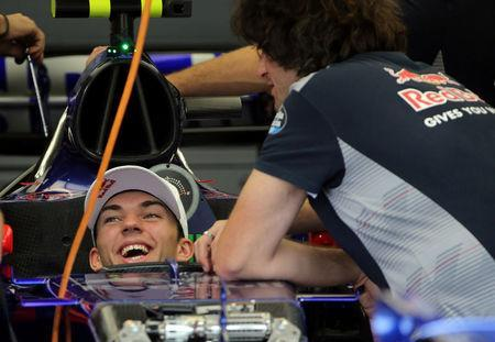 Toro Rosso Formula One driver Pierre Gasly of France sits in his car in the team garage at Interlagos circuit in Sao Paulo, Brazil November 9, 2017. REUTERS/Paulo Whitaker