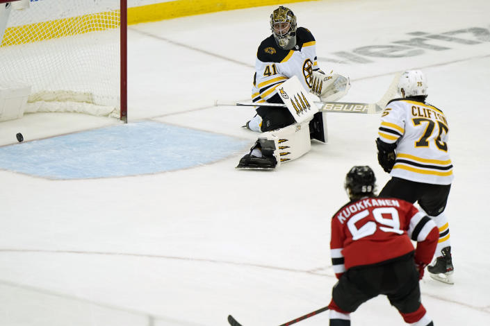 Boston Bruins goaltender Jaroslav Halak (41) watches a goal scored by New Jersey Devils center Yegor Sharangovich (17) cross the goal line during the third period of an NHL hockey game, Tuesday, May 4, 2021, in Newark, N.J. (AP Photo/Kathy Willens)