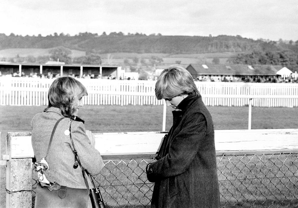Camilla Parker-Bowles (left) and Lady Diana Spencer (later the Princess of Wales) at Ludlow racecourse to watch the Amateur Riders Handicap Steeplechase in which the Prince was competing.   (Photo by PA Images via Getty Images)