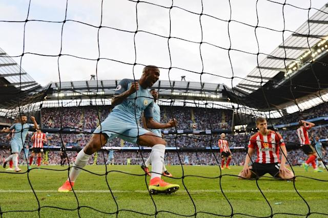 Manchester City's midfielder Fabian Delph (C) celebrates after Sunderland's defender Paddy McNair (2R) scored an own goal during the English Premier League match on August 13, 2016 (AFP Photo/Paul Ellis)