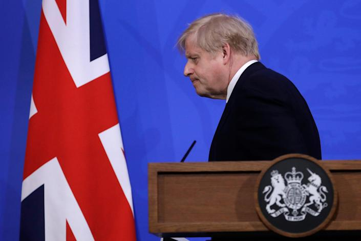 <p>The sheepish prime minister ends his news briefing with a hope and a prayer</p> (Getty)