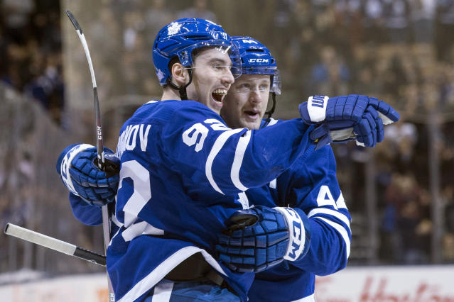Toronto Maple Leafs' Igor Ozhiganov (92) celebrates with Morgan Rielly after scoring his team's second goal during second-period NHL hockey game action against the Boston Bruins in Toronto, Monday, Nov. 26, 2018. (Chris Young/The Canadian Press via AP)