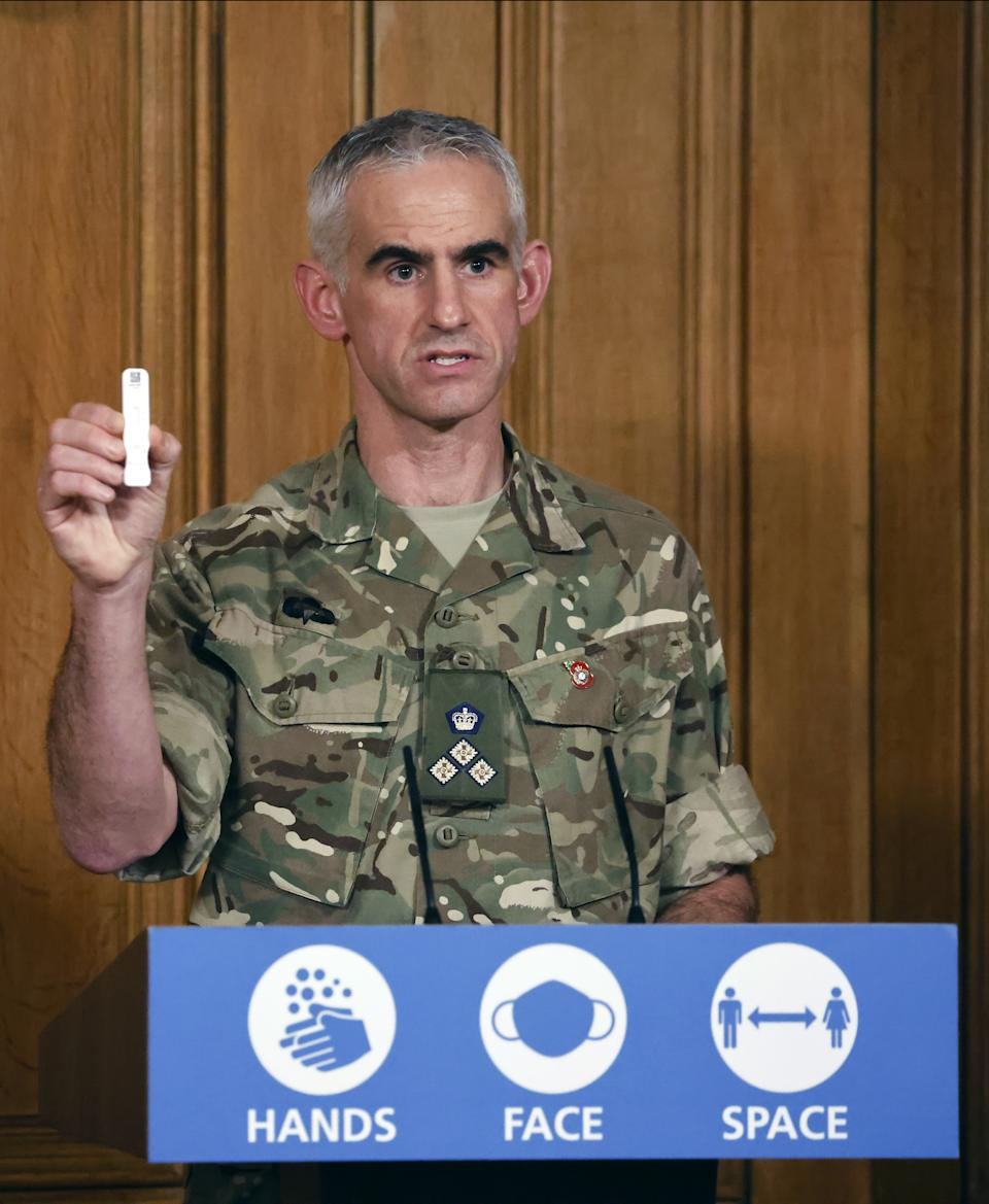 British Army Brigadier Joe Fossey, who is coordinating the mass coronavirus testing pilot in Liverpool, holds up the components of a lateral flow Covid-19 test as he speaks during a media briefing in Downing Street, London, on coronavirus (COVID-19).