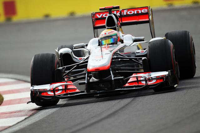 YEONGAM-GUN, SOUTH KOREA - OCTOBER 15: Lewis Hamilton of Great Britain and McLaren drives on his way to finishing first during qualifying for the Korean Formula One Grand Prix at the Korea International Circuit on October 15, 2011 in Yeongam-gun, South Korea. (Photo by Clive Rose/Getty Images)
