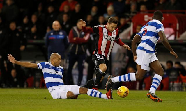 "Soccer Football - Championship - Sheffield United vs Queens Park Rangers - Bramall Lane, Sheffield, Britain - February 20, 2018 Sheffield United's Billy Sharp in action with Queens Park Rangers' Alex John-Baptiste Action Images/Ed Sykes EDITORIAL USE ONLY. No use with unauthorized audio, video, data, fixture lists, club/league logos or ""live"" services. Online in-match use limited to 75 images, no video emulation. No use in betting, games or single club/league/player publications. Please contact your account representative for further details."