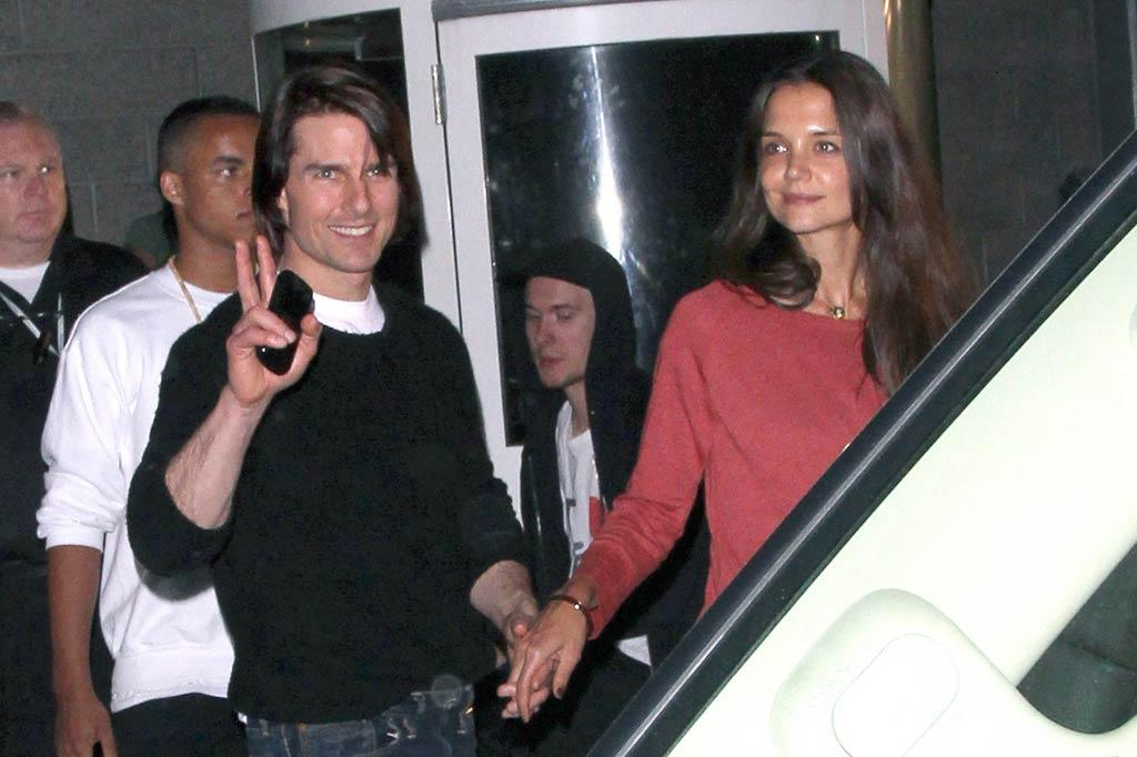 """The next evening, Katie and her hubby Tom Cruise had a date night at the Katy Perry concert. The pop star performed two nights in a row at downtown L.A.'s Nokia Theatre. Fellow celebs Demi Lovato and Lauren Conrad hit up the show, too. <a href=""""http://www.pacificcoastnews.com/"""" target=""""new"""">PacificCoastNews.com</a> - August 7, 2011"""