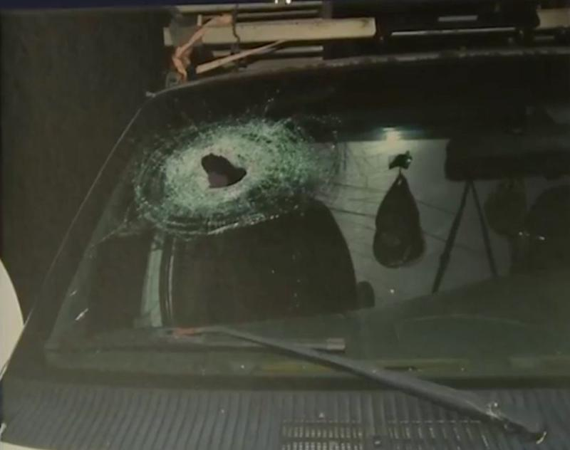 This photo shows a hole left in the windshield of a car that Kenneth Andrew White had been riding in at the time of his fatal injury.