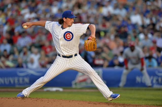 CHICAGO, IL - JUNE 23: Starting pitcher Jeff Samardzija #29 of the Chicago Cubs delivers a pitch during the second inning against the Cincinnati Reds at Wrigley Field on June 23, 2014 in Chicago, Illinois. (Photo by Brian Kersey/Getty Images)